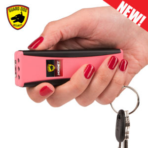 woman using pink stun gun