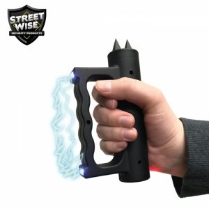 black brass knuckle stun gun in use
